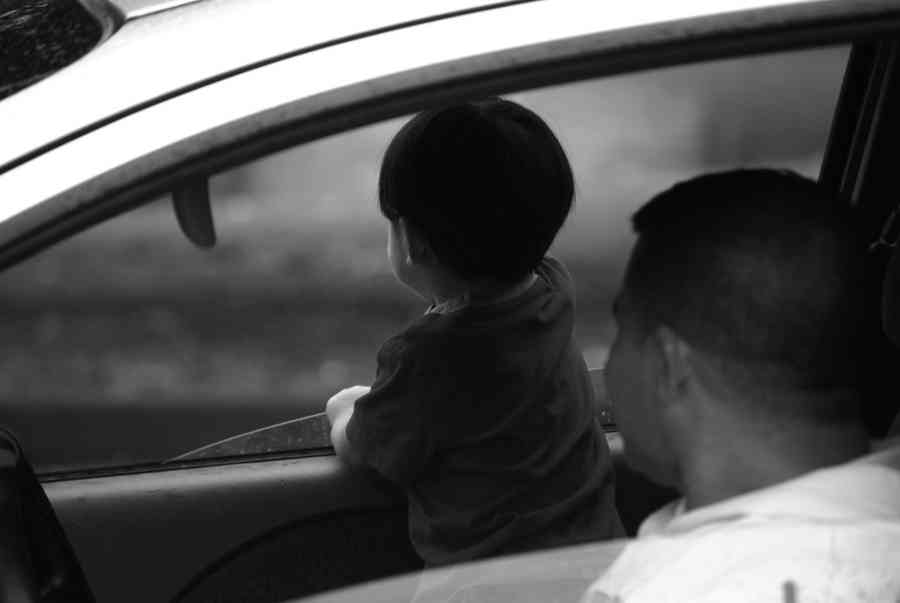 Child Looking Out A Car Window Brian Humek Photography